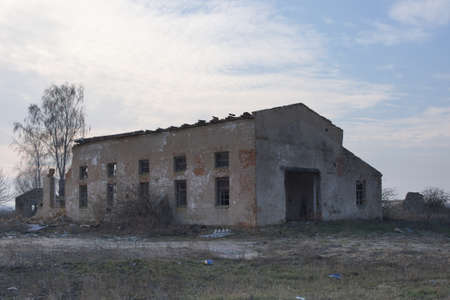 An abandoned industrial building at a farm enterprise in Ukraine. Evening landscape.