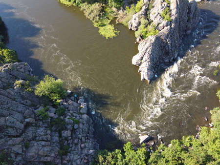 A bend of the Southern Bug river called Integral from a bird's eye view. A picturesque river among the rocky terrain.