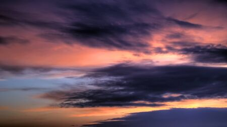 sunset clouds: dramatic sky, purple-red clouds at sunset in summer Stock Photo