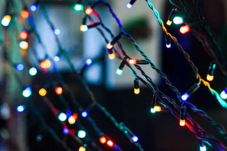 happy: Christmas holiday garland lighted with colorful lights Stock Photo