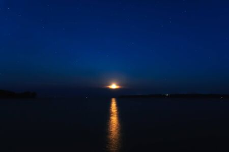 moonbeam: night landscape with moon and stars on a background of sky and river with reflection