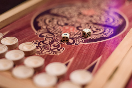 backgammon with dice for gambling in a casino with blurred background