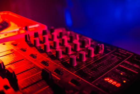 DJ mixer closeup with colored bright background r Reklamní fotografie