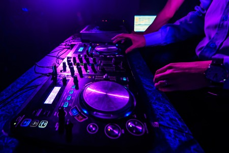 DJ controller and mixer controllers in the nightclub for disco
