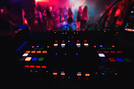glowing colorful buttons on mixer DJ party night club for dancing Stock Photo