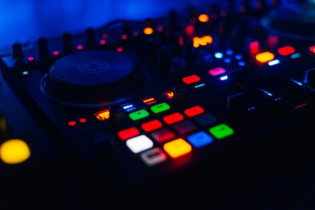 luminous button on tcontrol panel DJ for mixing and disk management