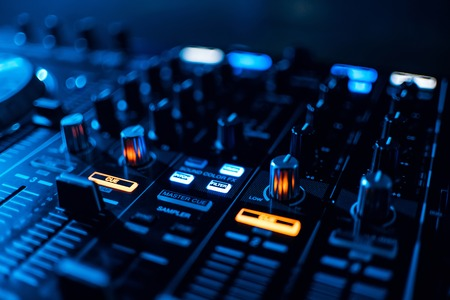 buttons mixer and control music on professional equipment DJ