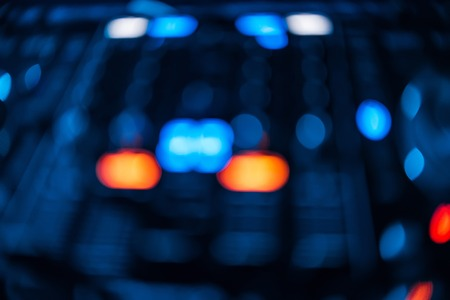 blurred glowing button, mixer DJ for mixing and controlling music in nightclub