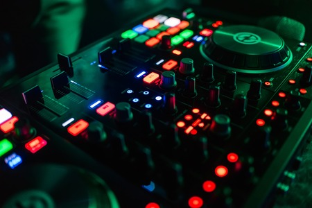 buttons and levels professional equipment, DJ mixing Stock Photo