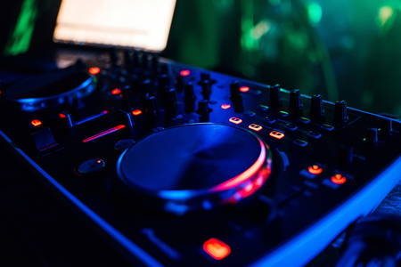 professional modern Board DJ mixing music and game discs