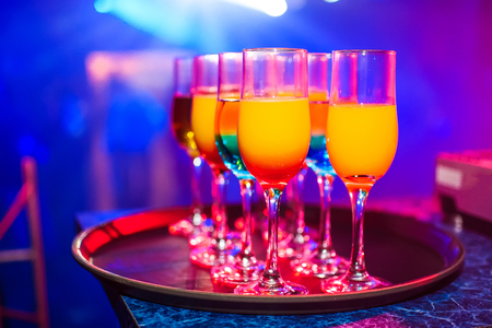 cocktails and alcoholic beverages in glasses at celebration in night club