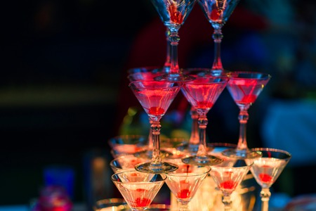 Martini glasses with cherries with red bright illumination