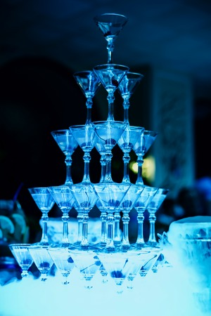 group of Martini glasses with bright blue illumination Stockfoto