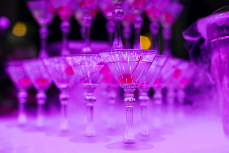 Martini glasses with sweet cherry close-up