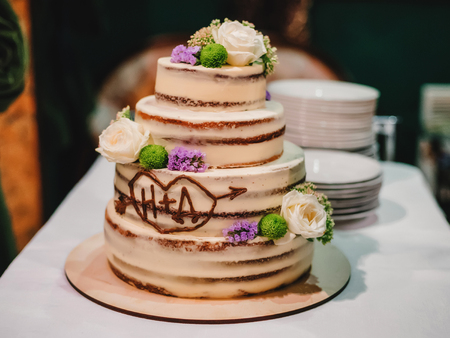 sweet wedding cake with tiers decorated with flowers