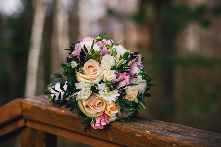 beautiful wedding bouquet with yellow roses, white chrysanthemums and pink Alstroemeria Stock Photo