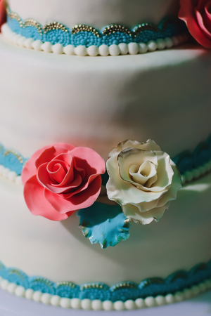 Wedding cake in white glaze with roses