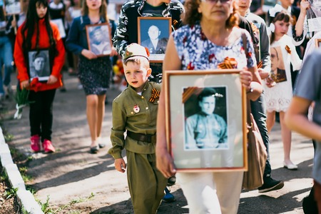 VICHUGA, RUSSIA - MAY 9, 2016: Immortal Regiment - people with portraits of their relatives, participants in the Second World War, on Victory Day parade Editorial