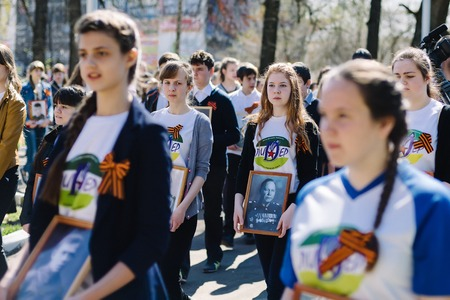 VICHUGA, RUSSIA - MAY 9, 2015: Immortal Regiment - people with portraits of their relatives, participants in the Second World War, on Victory Day parade Editorial