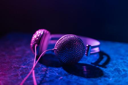 girl DJ headphones decorated with rhinestones in nightclub Stock Photo