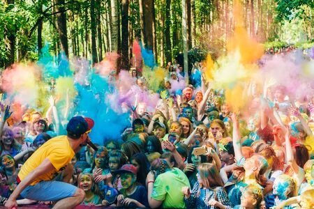 VICHUGA, RUSSIA - JUNE 17, 2018: Crowd of happy people at the celebration of the festival of colors Holi
