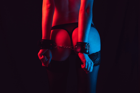 sexy ass girl with handcuffs in thongs and stockings Foto de archivo