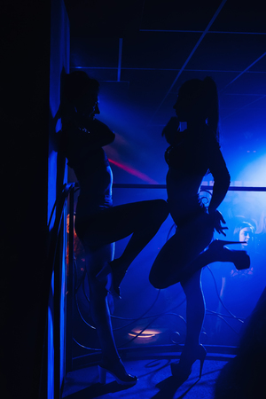 girl dancer in a nightclub posing on stage 版權商用圖片