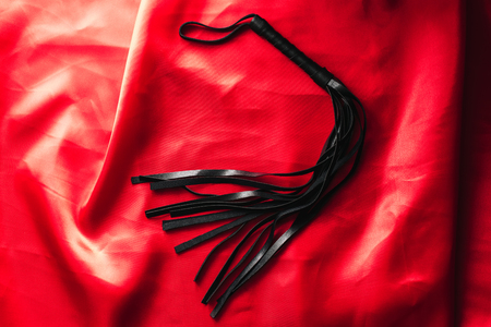 leather black whip for sex games in bdsm sex