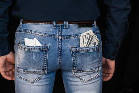 condoms and banknotes money in back pockets mens jeans