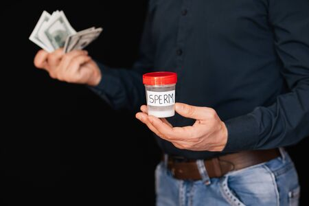 sperm Bank and money bills dollars in the hands Stock Photo