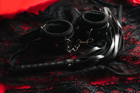 whip and handcuffs with lace underwear for BDSM
