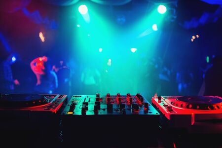 music mixer controller in DJ booth on dance floor