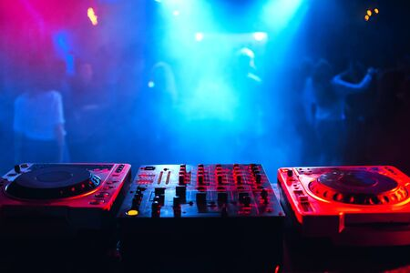 soundboard DJ console in the booth for mixing electronic music at a party