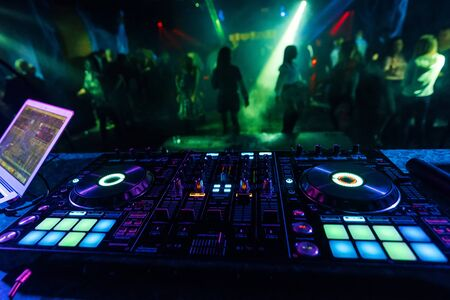 professional DJ mixer controller for mixing music in a nightclub Reklamní fotografie