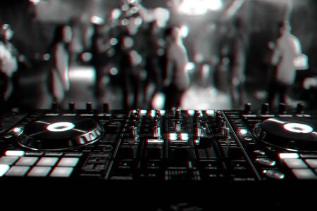 DJ mixer controller Board for mixing music in a nightclub at a party. Black and white photo with glitch effect and small grain Reklamní fotografie