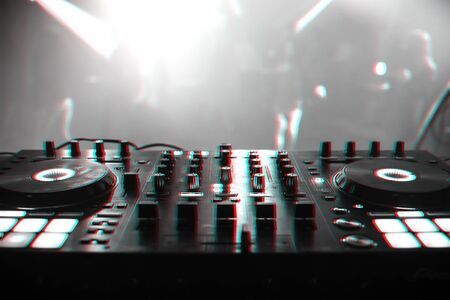 DJ mixer for mixing music and sound in a nightclub at a party. Black and white photo with glitch effect and small grain Reklamní fotografie