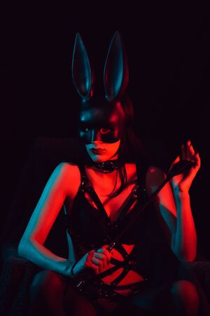sexy mistress girl masked Bunny in leather belt Фото со стока