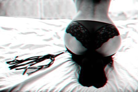 big girl in panties with leather whip for BDSM on the bed
