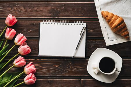 bouquet of pink tulips with a Cup of coffee and a croissant