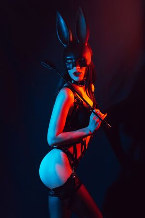 mistress girl with sexy ass in lingerie in Bunny mask with leather whip for BDSM sex