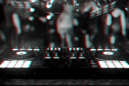 professional DJ controller for mixing electronic music in a nightclub. Black and white photo with glitch effect and small grain Stock Photo