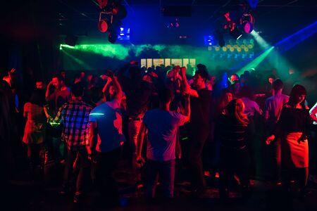 people dancing in a nightclub on the dance floor