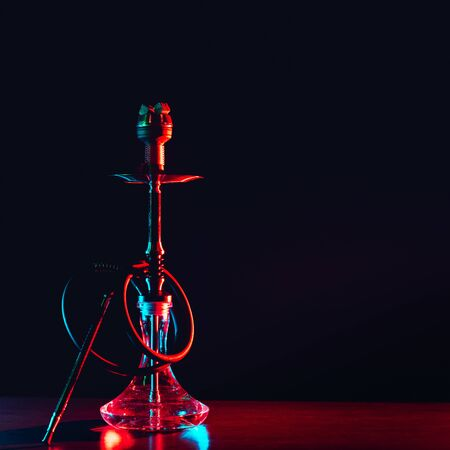 hookah shisha with coals on the table on a black background Banco de Imagens