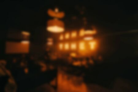 interior of the restaurant bar is out of focus with a blur. Abstract blurred yellow background