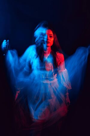 blurred mystical scary portrait of a young Ghost girl with mental disorders