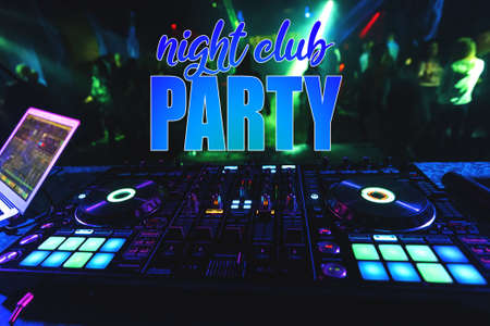 inscription Night Club Party on the background of the DJ mixer