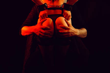 male dominant holds hands sexy ass submissive girl in handcuffs
