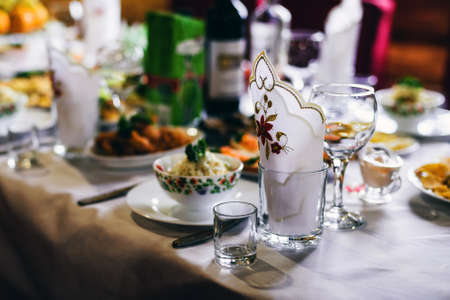 festive table with glasses and food for a romantic dinner in the restaurant