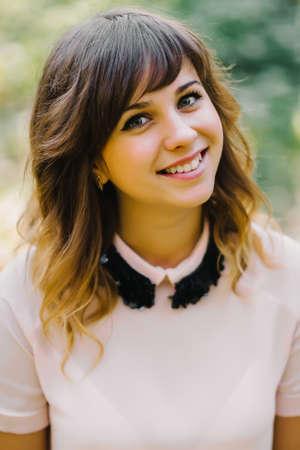 portrait of beautiful smiling brunette girl in autumn