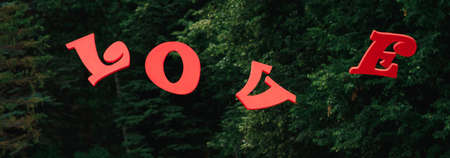 red wooden letters love on the background of the forest Stock fotó